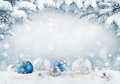 Merry Christmas Card. Blue Christmas Balls And Baubles On The Snow With Fir Branches. poster