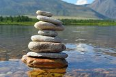Stones Meditation Figures. Symbolical Statue Of Several Stones. Tradition To Collect  Stones In Priv poster