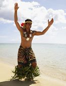 stock photo of pacific islander ethnicity  - Pacific Islander man in traditional dress on beach - JPG