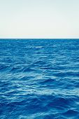 Blue Sea Surface Background With Waves And Horizon poster