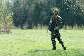 foto of hider  - The soldier with the weapon during war - JPG