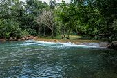 Mountain River With Stones. Fast Water Current. Water Photo Texture. Grey River In Tropics Wallpaper poster