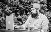 Bearded Hipster Freelancer Enjoy End Of Working Day With Beer Mug. Beer Helps Him Relax After Hard D poster