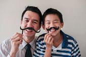 Happy Mixed Father And Preteen Son Having Fun With Fake Mustache. November Blue And Men Health, Fath poster