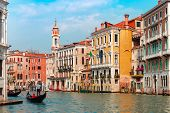 Gondolier Carries Tourists On Traditional Gondola Along Grand Canal In Summer Sunny Day, Venice, Ita poster