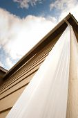image of downspouts  - Downspout on an urban house and sky - JPG