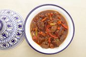 stock photo of tagine  - A moroccan beef tagine served in the traditional tagine dish - JPG