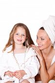 stock photo of housecoat  - Happy daughter in a bathrobe and cheerful mother looking at her - JPG