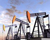 stock photo of oil derrick  - Illustration of three oil rigs in the desert - JPG