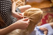 Woman Braids Braids To A Young Girl. Female Hands Weave Braids poster