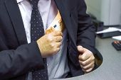 Office Worker Takes A Euro Bribe At The Workplace In The Office. The Concept Is Corruption. Take A B poster