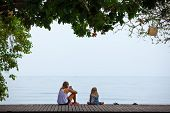 Happy Mother, Child Relaxing And Talking On Luxury Hotel Veranda With Beautiful View. People Looking poster