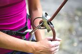 Climbing Belaying. A Woman Insures Her Partner. Safety Equipment. Safety System. Rock Climbing Safet poster