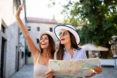 Young Happy Tourists Women Sightseeing In City On Vacation poster