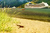Fjord Shore, People Kayaking On Water And Cruise Ship On Aurlandsfjord In Norwegian Tourist Destinat poster