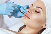 The Doctor Cosmetologist Makes The Rejuvenating Injections Procedure For Tightening And Smoothing Wr poster
