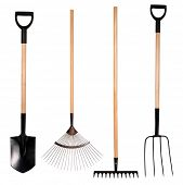 Gardening tools,  spade, fork and rake isolated on white background