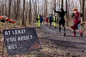POCONO MANOR, PA - APR 28: Participants run past a sign that reads At Least You Aren't Wet at Tough