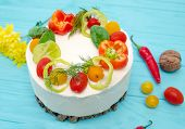 Appetizing Cake With Chicken Meat, Eggs And Salad. Snack Cake. Wooden Board With Hot Peppers And Tom poster