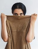 Portrait Of Pretty Young Woman Hiding Her Face Under Clothes. Attractive Muslim Girl Hiding Face Und poster