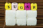stock photo of diabetes symptoms  - Sugar lumps and word sugar - JPG