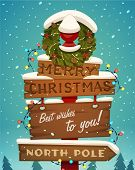 foto of christmas wreath  - Snow covered wooden sign - JPG