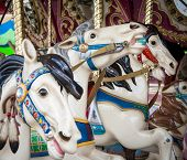 image of merry-go-round  - Colorful carousel horse on a merry go round - JPG