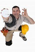 pic of smoke detector  - Electrician with a smoke alarm - JPG