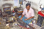 Silver Smith At Work In His Shop