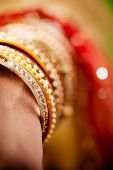 stock photo of bangles  - bridal decorative gold diamond  bangles in hand during festival or party  - JPG