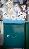 Post box with daily newspapers flying out