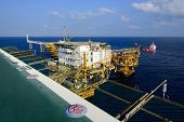 picture of big-rig  - The big offshore oil rig platform and supply boat