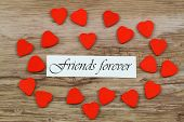 picture of  friends forever  - Friends forever card with little wooden hearts on wooden surface - JPG