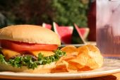 image of potato chips  - Perfect cheeseburger outside in summer with lemonade and watermelon - JPG