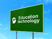 Education concept: Education Technology and Head With Gears on road sign background