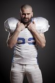 American football player  on the uniform, studio shoot