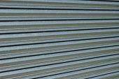 foto of roller shutter door  - Section of a steel roller shutter door on a diagonal slant - JPG
