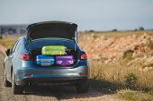 stock photo of car ride  - Car full of suitcases and bags to return from summer holidays - JPG
