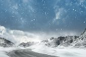 image of computer-generated  - Country road leading through a winter mountain landscape.