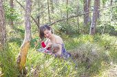 picture of breastfeeding  - youn mother breastfeeding her baby in the forest in springtime - JPG