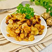 picture of jerusalem artichokes  - Jerusalem artichokes fried in a dish fresh tubers napkin parsley vegetable oil on a background of white wooden plank - JPG