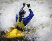 picture of kayak  - Whitewater kayaker hitting the wall of water - JPG