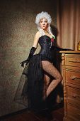 foto of tight dress  - Young attractive courtesan in a lush wig and dressed in a tight fitting corset dress - JPG