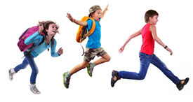 stock photo of schoolboys  - Group portrait of happy schoolgirl and schoolboys with a backpacks running and jumping together - JPG