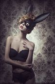 picture of lace  - Dark easter portrait of sensual curly woman with romantic expression posing with mysterious bunny mask and lace lingerie - JPG