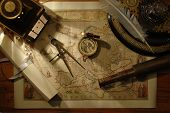 picture of treasure map  - nautical navigation tools on old map - JPG