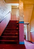 stock photo of brothel  - Staircase with red Carpet in a Brothel - JPG