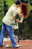 picture of pier a lake  - Couple of young lovers hugging on the pier of the lake - JPG