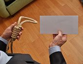 image of hangman  - Hangman holding a white chart and letter message - JPG