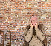 image of sorrow  - portrait of elderly man in sorrow holding head in hands - JPG